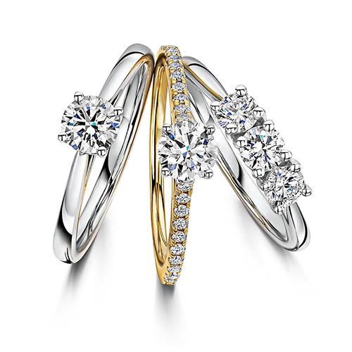 jewelry retouching service,edit three diamond rings on white background